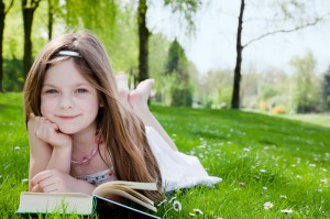 child-reading-book-outside