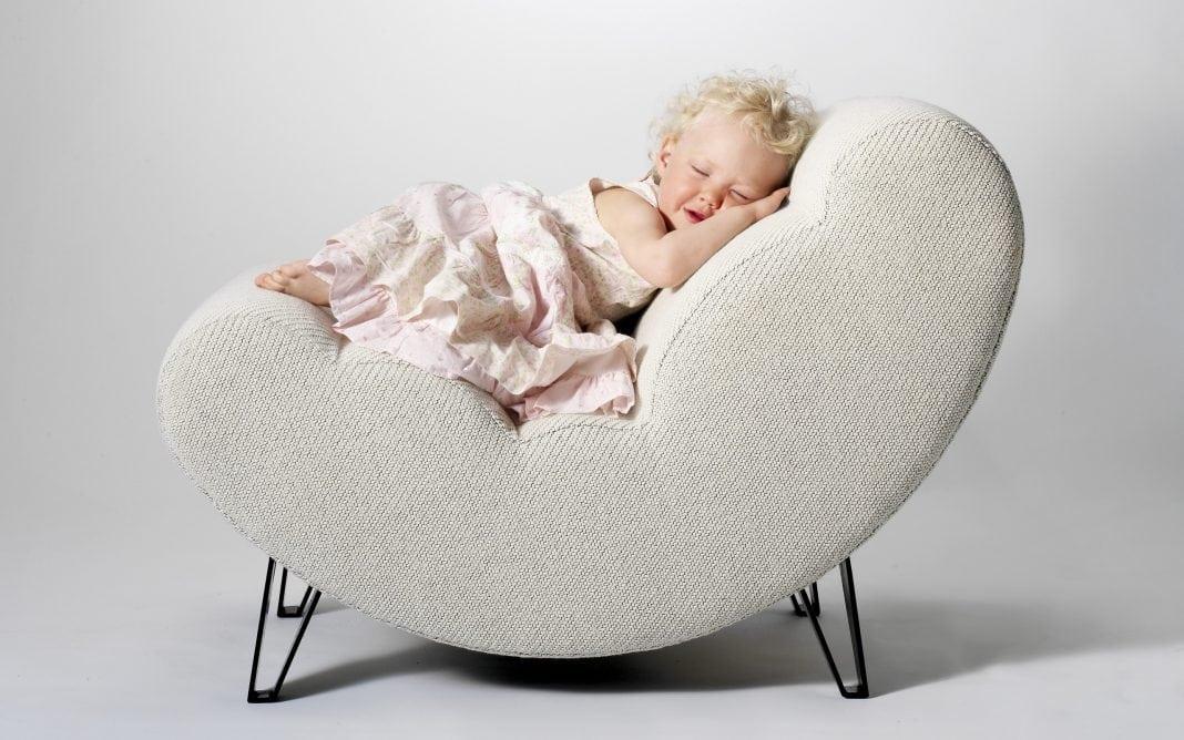 cute baby girl sleeping on the chair
