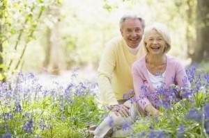 Senior couple in bluebell woods