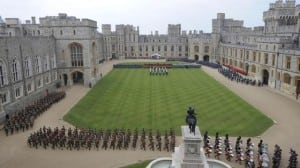British armed forces personnel march during Queen Elizabeth's Diamond Jubilee Parade and Muster in Windsor