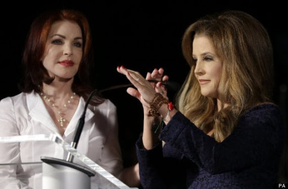 Priscilla Presley, left, Elvis Presley's ex-wife, and Lisa Marie Presley, right, Elvis Presley's and Priscilla Presley's daughter, speak to fans gathered at a candlelight vigil at Graceland, Elvis Presley's Memphis, Tenn. home, on Wednesday, Aug. 15, 2012. Fans from around the world are at Graceland to commemorate the 35th anniversary of Elvis Presley's death. (AP Photo/Mark Humphrey)