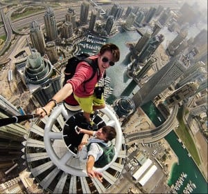SELFIE Daredevil Alexander Remnev after scaling the 1,350ft Princes Tower in Dubai, the world's tallest residential building http://www.dailymail.co.uk/travel/article-2633663/Daredevil-skywalkers-snap-death-defying-selfies-Dubais-Princess-Tower-1-350-FEET-ground.html