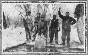 five men cut large blocks of ice from frozen lake nara 285481 640x400
